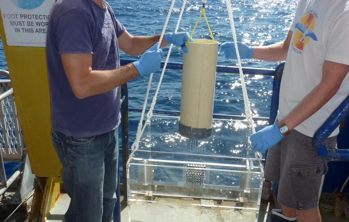 Dr Seymour (R) deploying a prototype microfluidic system in the ocean from the CSIRO research vessel, RV Southern Surveyor.