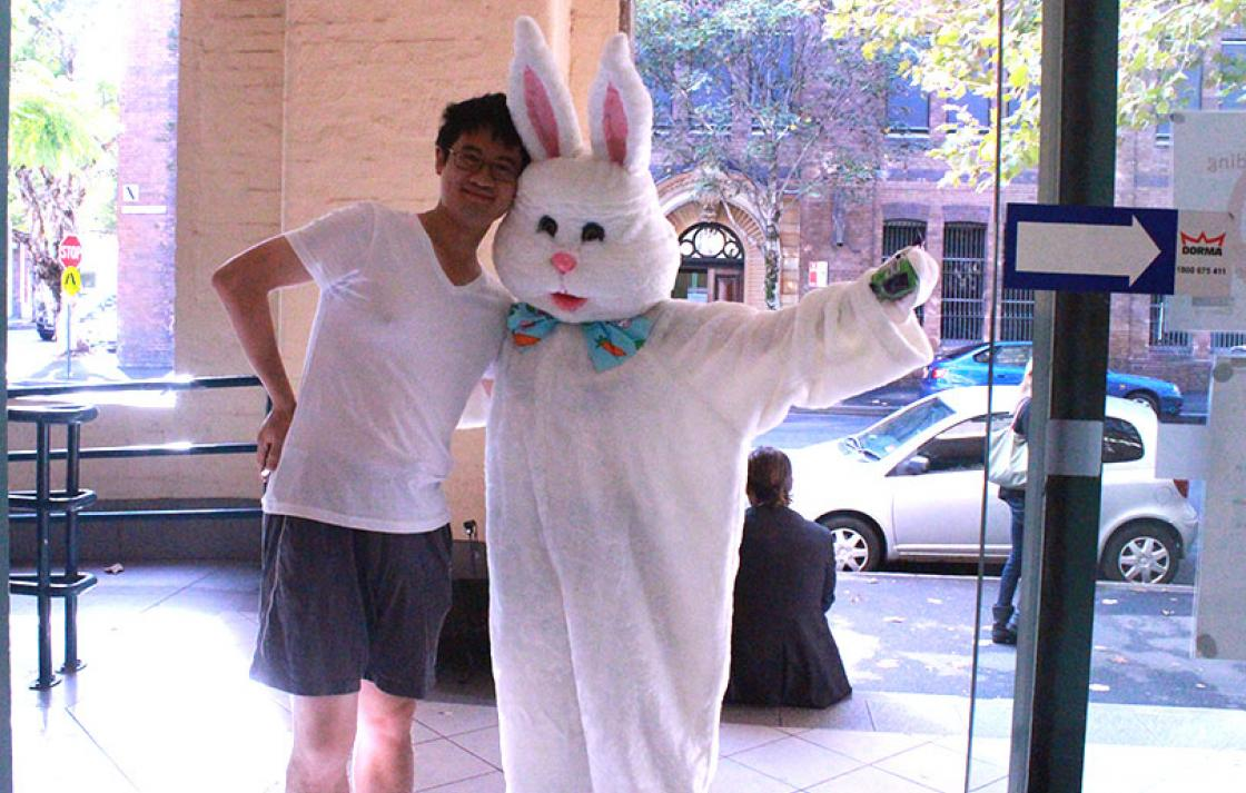 Guy with a person in a rabbit suit