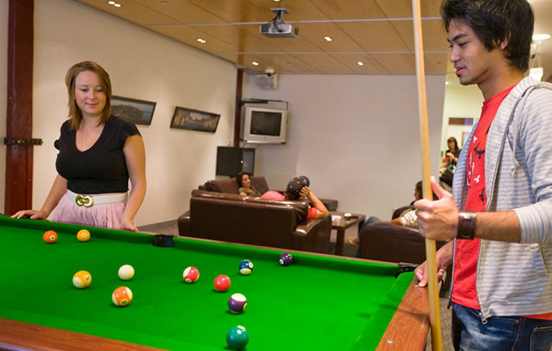 Guy and girl playing snooker