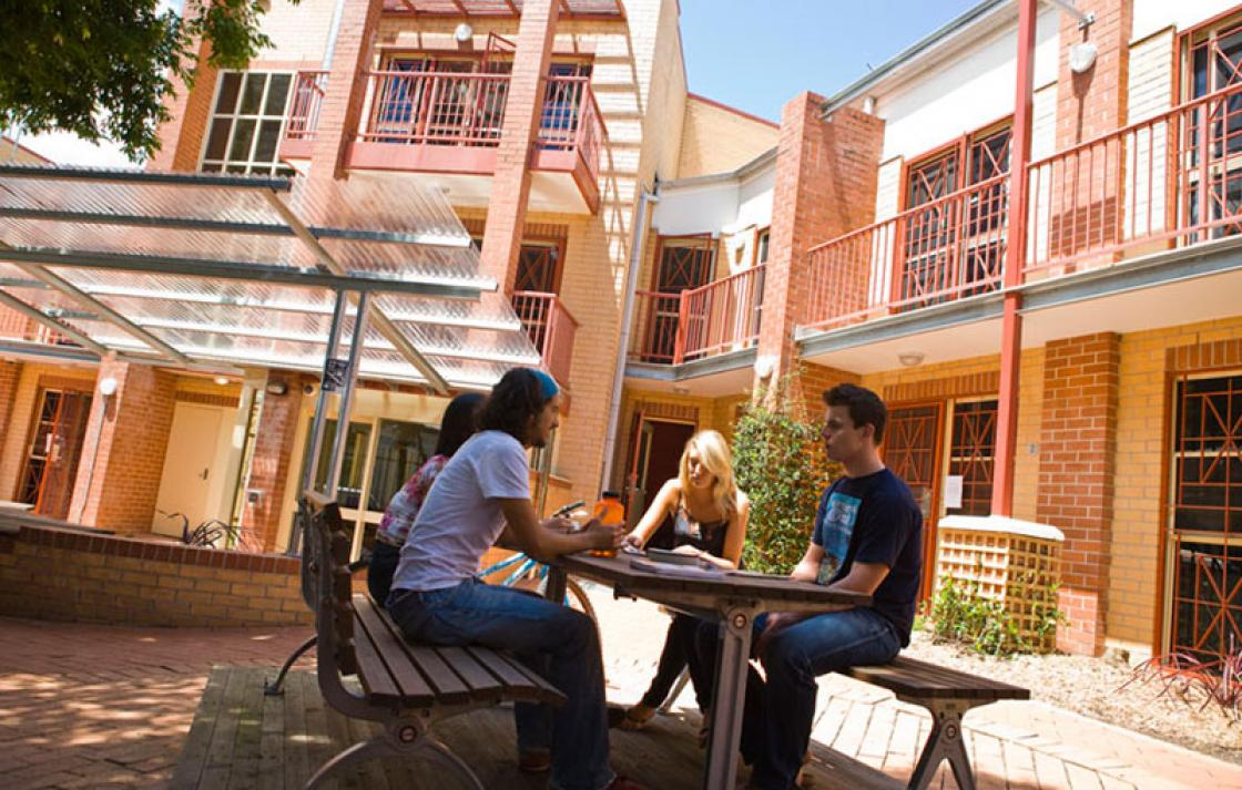 Students sitting in a courtyard area