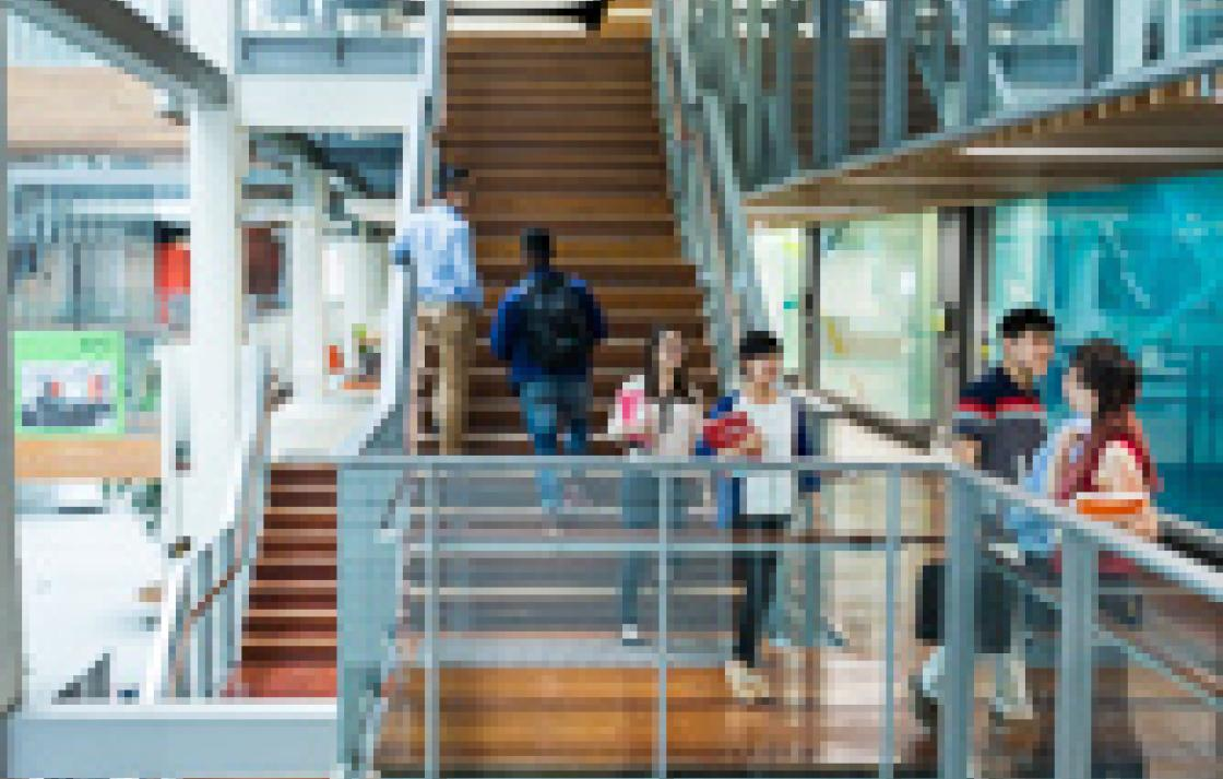 Photo of students on the stairs in the Building 10 atrium
