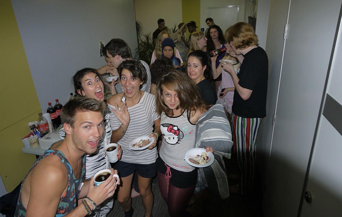 Students having fun at pajama food party