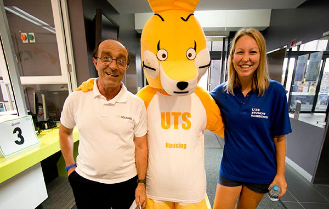UTS Housing mascot with two people