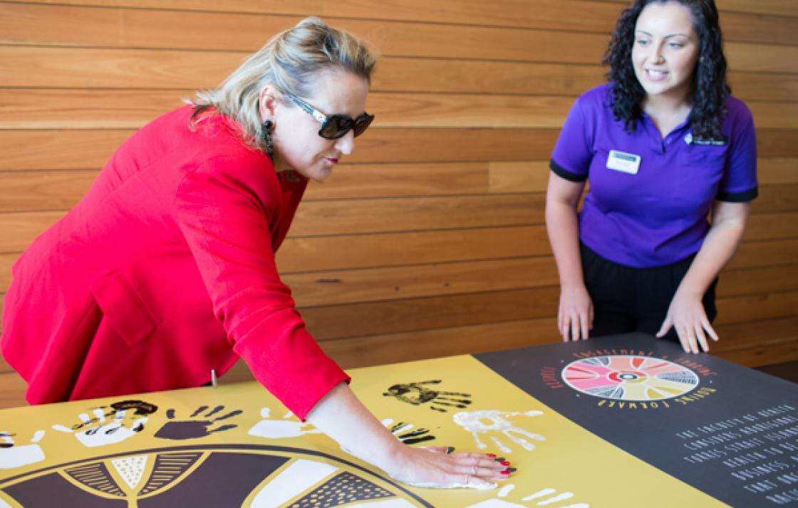 Attendees leave a handprint to show their support
