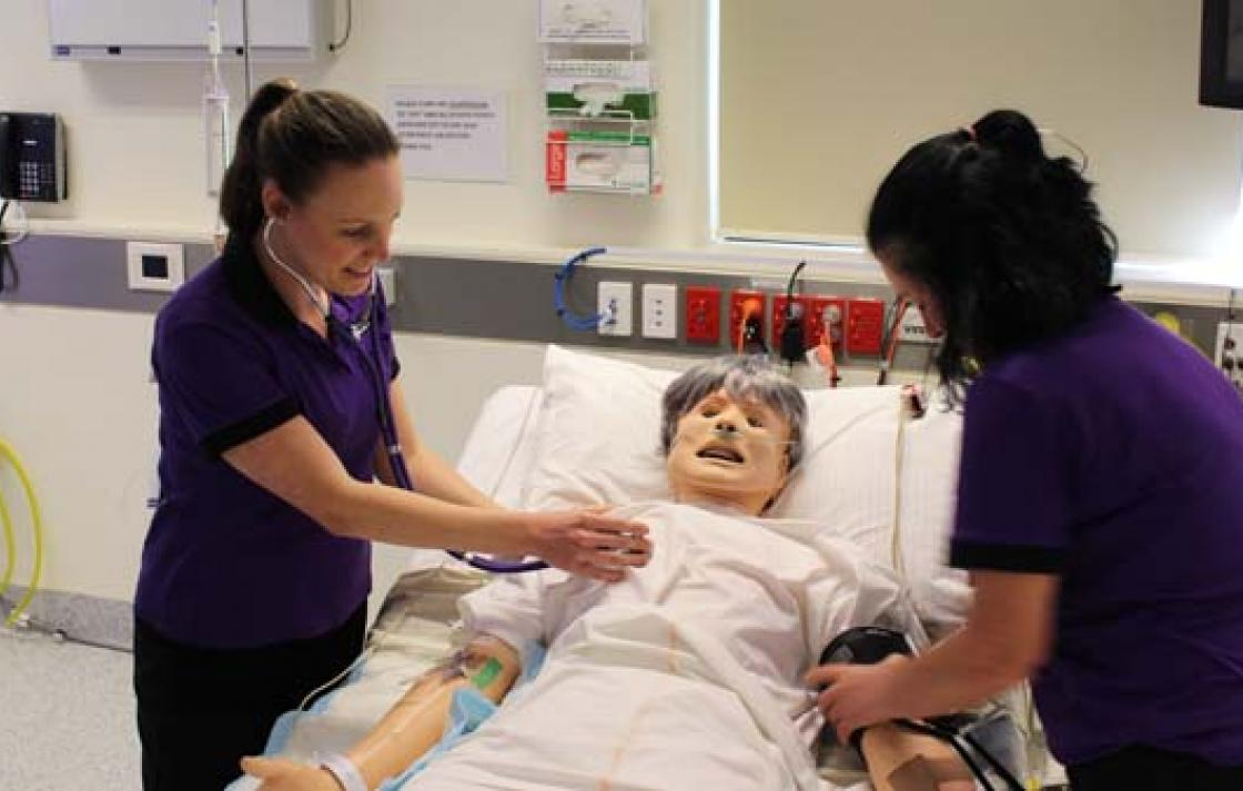 Students in a critical care simulation