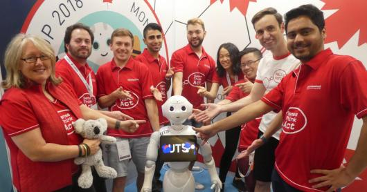 UTS Unleashed! team in Montreal with a Pepper robot.