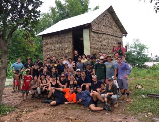 UTS DAB students and locals in front of a house they built in Cambodia