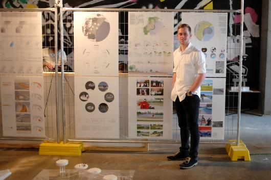 Landscape Architecture students Jeremy Chivas stands in front of his architectural panels at the UTS Festival of Architecture and Landscape 2016