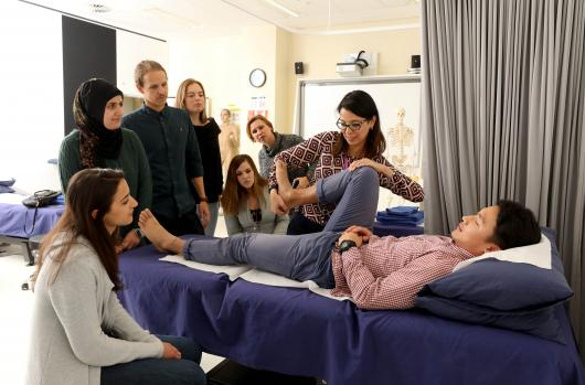 Students watch a physiotherapy demonstration