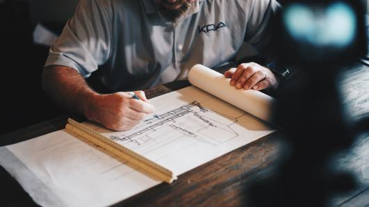 Construction design being drawn by architect