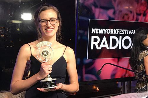 History Lab producer Ninah Kopel grasps the trophy at the New York Festivals Radio Awards