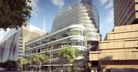 An artist's impression of UTS Central with a glistening glass facade and curved design, looking from Broadway with the UTS Tower to the right.
