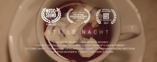 Coffee cup with award logos over the top. Stille Nacht movie promotion image.