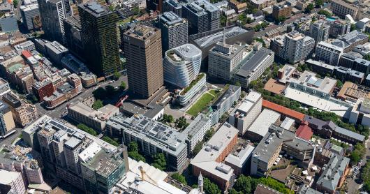 An aerial view of a number of city blocks, including the UTS Tower and surrounding UTS buildings