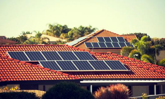 Stock picture of solar panels on a suburban house roof