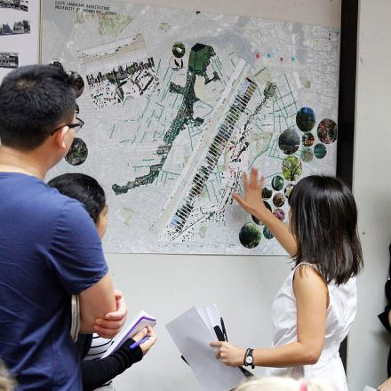 group of people looking at landscape plans