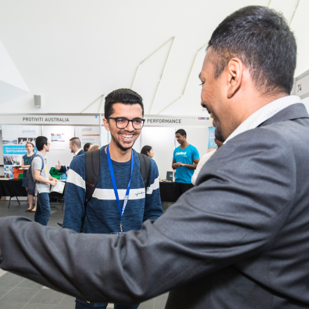 UTS Information and Technology student talking to an employer at the UTS Careers Fair March 2018