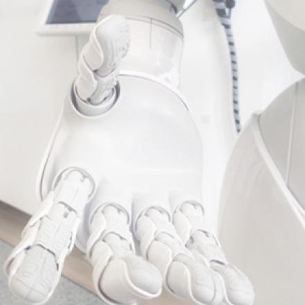 Image depicts a close-up hand of a robot reaching out towards the viewer