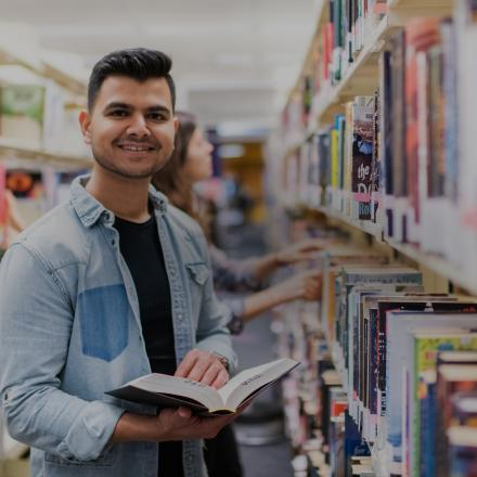 male student at library