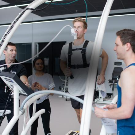 athlete running on a treadmill will trainers monitor his performance