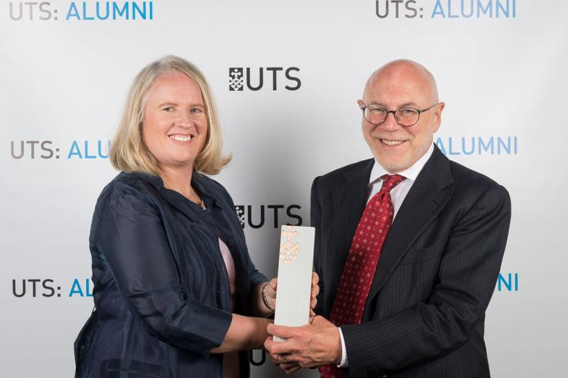 Rachel Grimes receiving her 2017 Business Alumni Award from Professor Roy Green
