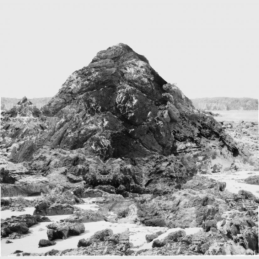 black and white photograph of a rock formation
