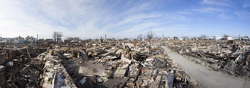 A neighbourhood showing devastation with house debris strewn everywhere
