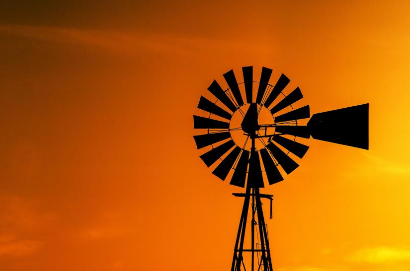 A windmill at sunset