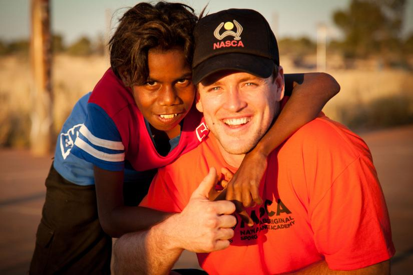 UTS student with indigenous child smiling