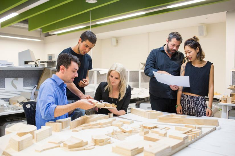 5 people working together on a architecture model