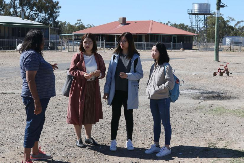 3 UTS students talking to a Walgett residents
