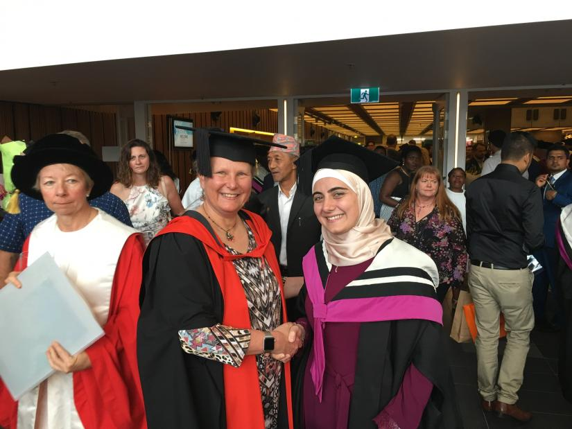 Ghina El Badwi El Najjar during Graduation with one of the academics.