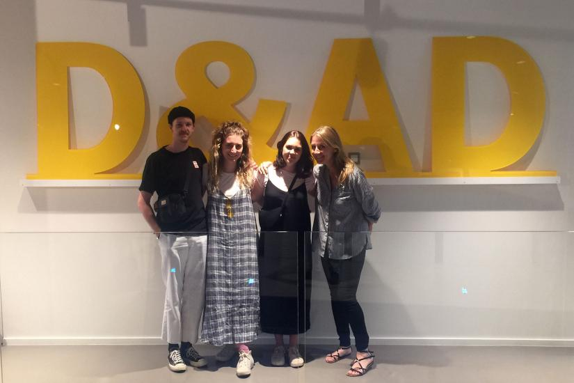 4 people in front of the D&AD company Logo