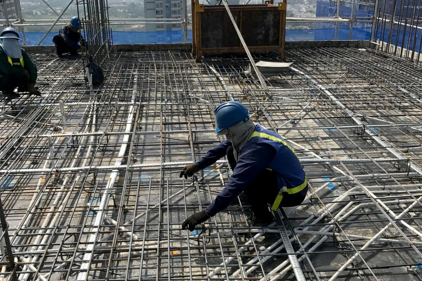 construction worker laying steel reinforcement