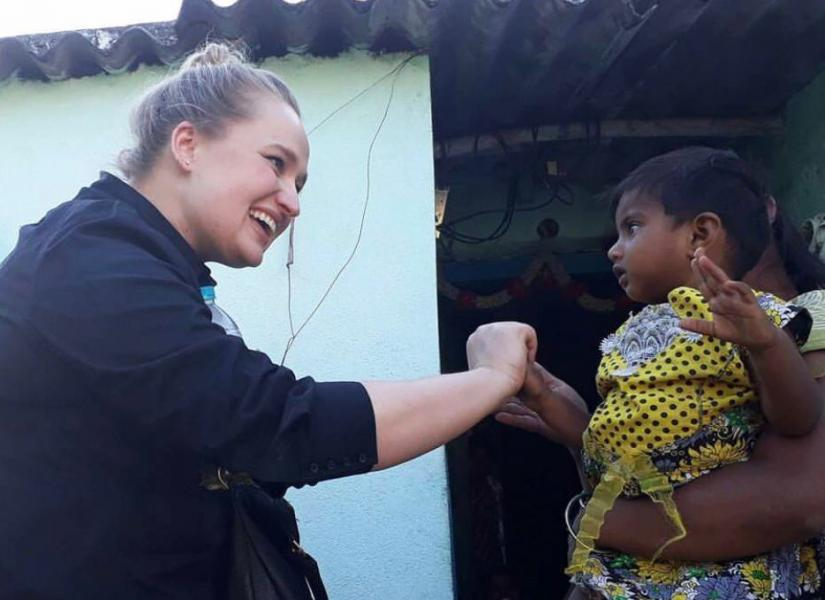 Alyce with child in India