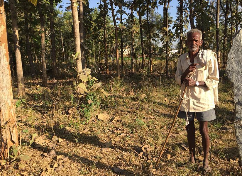 Rural Indian farmer posing for photo