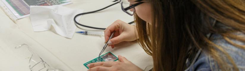 Student working on circuit board