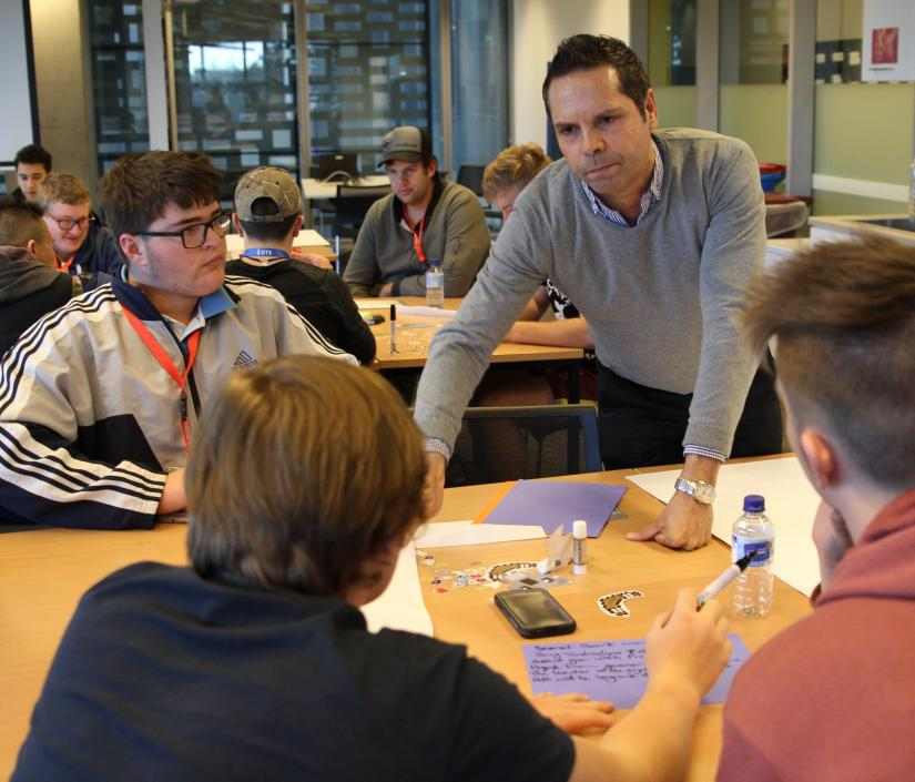 Chris Lawrence leading a games development workshop with indigenous students
