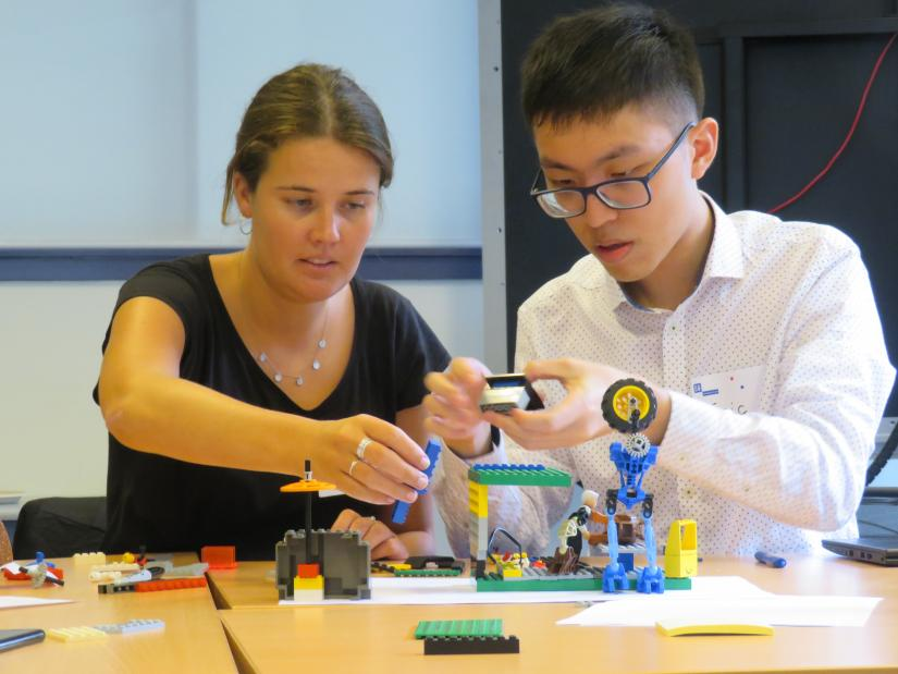Photo: Law student, Lucinda Campbell and Eric Shi from Allens use Lego to help with App ideas