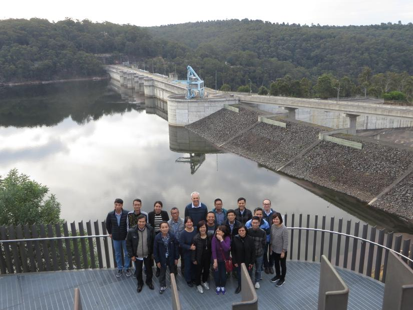 A group of people stand on a viewing platform above Warragamba Dam