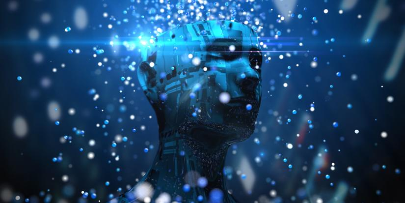 digital illustration of a person's bust made from circuit boards. The top of the head is missing and blue spheres of light are cascading from the hole.