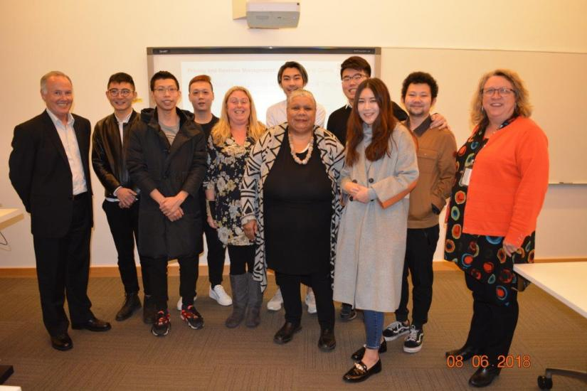 UTS Pricing students posing with a representative from Tranby National Indigenous Adult Education and Training.