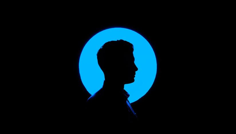 Silhouette of a man on a blue circle