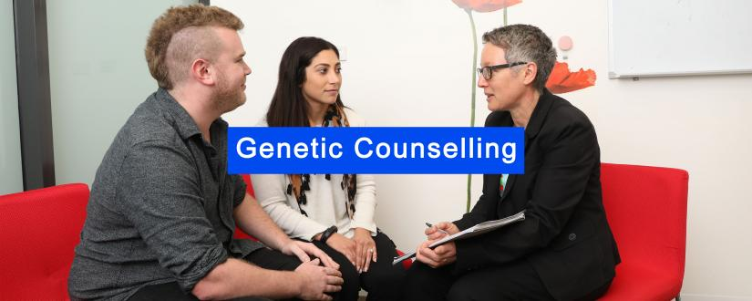 Male and female clients sitting and talking to female genetic counsellor