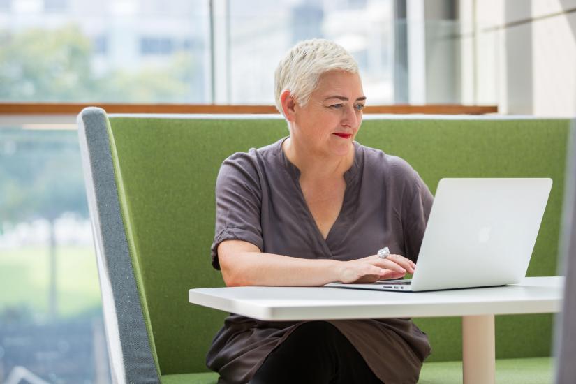 Deb Verhoeven sitting at a desk