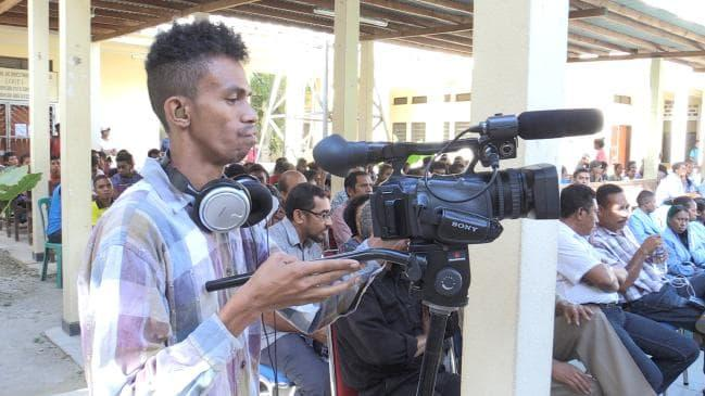 An East Timorese journalism student trains using equipment donated by University of Technology, Sydney