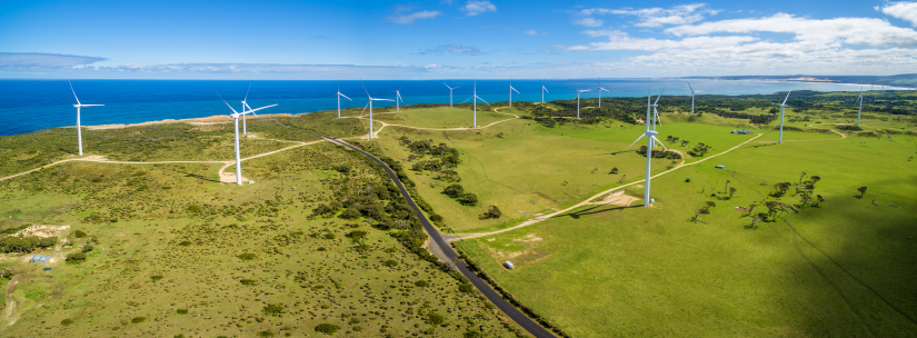 Aerial panorama of rural road and wind farm in Australia