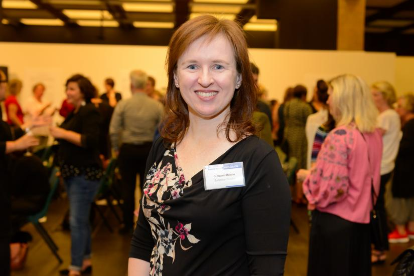 Naomi Malone posing and smiling while at her 'Access leads to inclusion' exhibition launch.