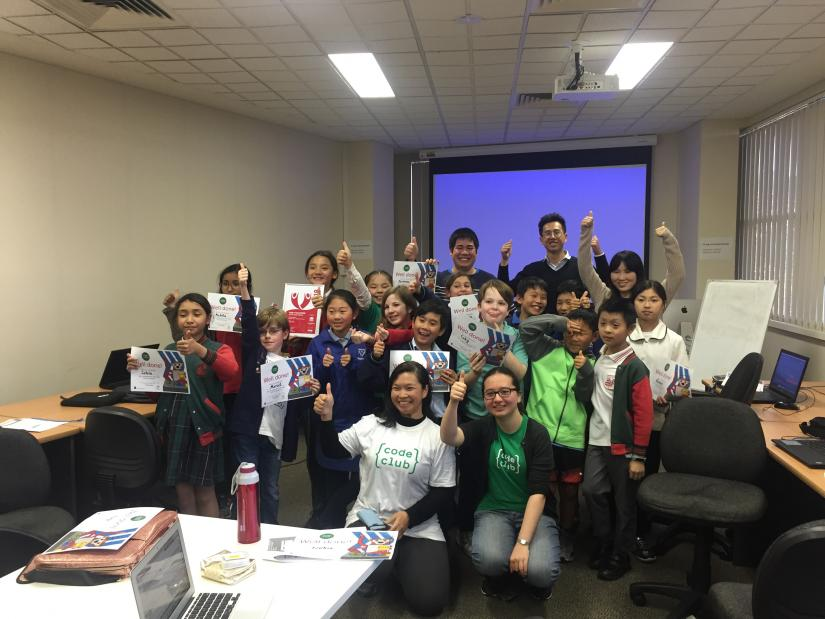 Chau Au posing with a group of students at Code Club at Randwick library