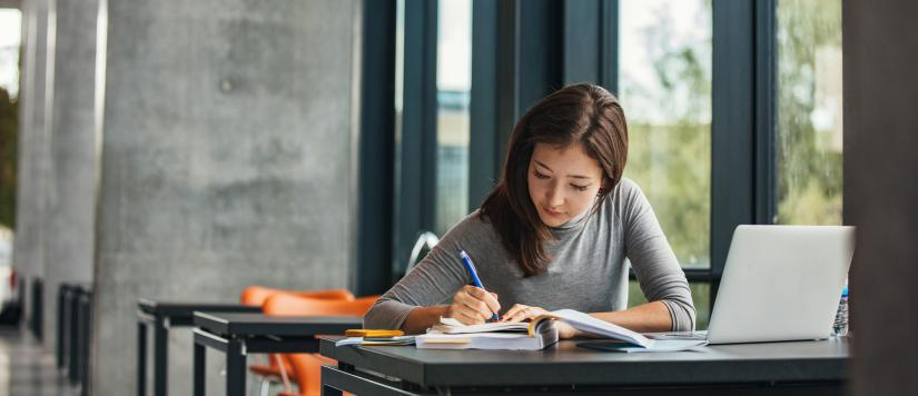 Female student sitting at desk studying